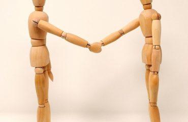 woodden figure resembling negotiating